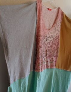 takes one fashion t shirt for center panel and 4 large t shirts cut into rectangles for each side, bottom front and bottom back.  Refashion Co-op: Love Flow Creations