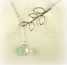 Sweet piece of genuine aqua sea glass is perfect for this beautiful, pearl and leaf lariat necklace! The sea glass and Swarovski crystal pearl dangle through the smallest of the leaves. Its weight mak