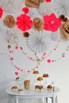 Truly splendid party decorations from Something Splendid. Love the pop of neons against the brown and white neutrals.