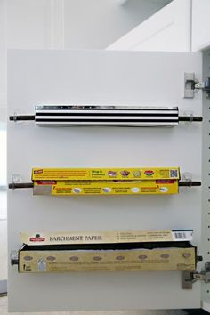 For life's messiest moments, you need foil and plastic wrap dispensers conveniently mounted inside your cabinet. Click through for more on this and other cabinet storage ideas.