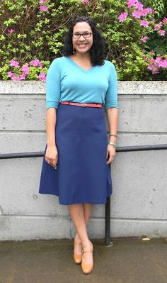 Turquoise shirt, pink belt, and navy skirt. #colorblock