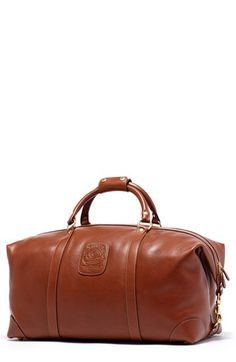 Free shipping and returns on Ghurka 'Cavalier II' Travel Duffel Bag at Nordstrom.com. A handsome duffel bag handcrafted from soft, tumbled leather and durable brass hardware is specially designed with folded ends that can be unclipped to accommodate extra room for packing. An embossed Ghurka crest stamps this bag with elevated style.