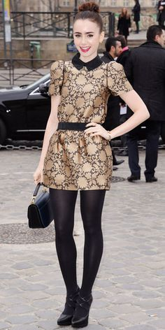 Lily Collins WHAT SHE WORE Collins took in the latest Louis Vuitton collection in the label's gold minidress, leather bag and strappy heels. Look of the Day - InStyle Cozy Fashion, Party Fashion, Fashion Beauty, Fall Fashion, Vanity Fair, Celebrity Dresses, Celebrity Style, Black Opaque Tights, Black Nylons