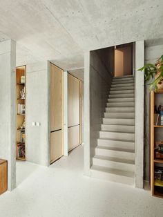 The staircase of ISM Architecten's stark concrete house, which is topped with a glass study.