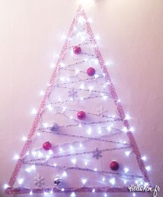 "Short on space and skipping a real Christmas tree this year? Consider this pretty space-saver. Gonna recreate this wall ""tree"" with our indoor LED string lights: http://www.flashingblinkylights.com/sparklingwhiteballledpartylights.html?utm_source=pinterest&utm_medium=led%20light%20up%20string%20lights&utm_campaign=christmas%20lights%20crafts"