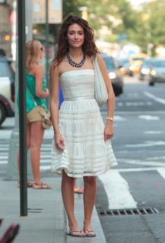 Emmy Rossum: Emmy wore her blue flip-flops with a dressy ivory strapless dress, a blue beaded necklace, and a white Bottega Veneta bag in NYC. Mimic her look by pairing your fancy dresses with casual flip-flops.