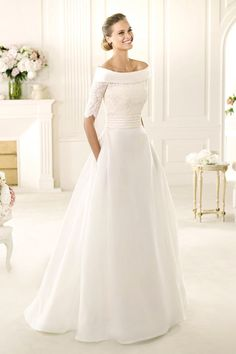 Winter wedding dress pronovias This dress is beautiful. I just wish the collar of it wasn't such a thick, harsh line.. But I do love the style of it..