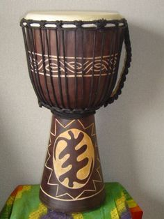 "20"" X 10-11"" Deep Carved Djembe Bongo Drum GYE NYAME (God First) with Free Cover, Model # 50M12 by Made Drums. $72.99. We've been selling high quality percussion since 2001. All our drums are professionally hand produced with a stringent quality control.  Each djembe is specially crafted with sound quality and playability in mind, with additional attention give to aesthetics. All of our djembes are backed up by our 100% satisfaction guarantee. Buy with confidence, each..."