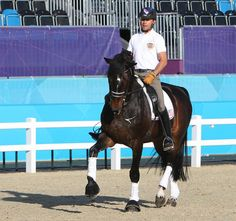 Steffen Peters and Ravel getting used to the main Olympic competition arena in London. © 2012 Ken Braddick