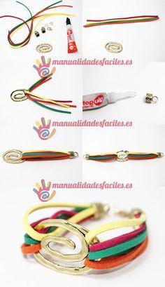 Materiales:      -Cordón de antelina de varios colores      -Entrepieza espiral dorada      -cierres de tubo dorados      -anillas y mosquetones      -pegamento adhesivo fuerte