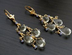 Valencia Collection Chandelier Earrings. Hand Made 14k gold-fill chandeliers, Green Amethyst and Tanzanite. The movement in these earrings are amazing. This was such a challenge to design but it has been a classic for Anthony Angel Fine Jewelry. Want a custom pair made in your gem choices? message me:-)