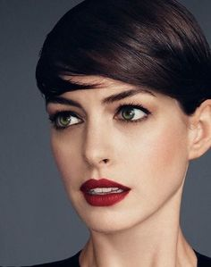 Dark brown / black pixie cut / short hair with pale skin and green / hazel eyes - Anne Hathaway red lips beautiful makeup classic