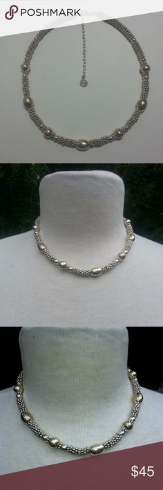 """Napier silverplated bead collar necklace 16"""" The silver plating is high quality on this graduating bead collar-length necklace. It would do for a choker necklace on a larger neck. It has a 3"""" extension chain so it can be worn at 19"""" length. Some of the larger beads have begun to tarnish a bit, it can be polished off and the entire necklace will shine like crazy. The darker beads do make a nice visual contrast, if you leave it alone. If you wish to purchase this and want it polished, I can do…"""