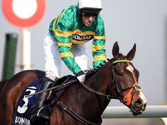AP McCoy winning the Aintree Hurdle on Jezki.