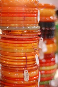 Stacks of orange Bakelite bangles. When you find them grab a bunch quickly because they are becoming more difficult to find. (I have other bakelite bangles in my collections board)