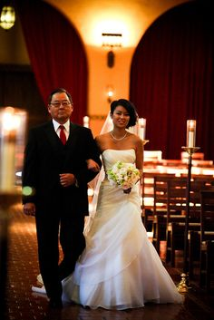 This bride walks down the aisle at Mission Santa Clara with her father.