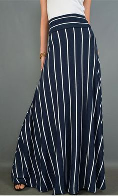 Women's flared A-line maxi skirt with foldable banded waist and vertical white stripes available in navy and black. Stripes are a coming trend this year and these skirts will go casual or dressy matching any styled top and adding a modest and trendy flare to your wardrobe! This is a long skirt that can also be worn as a dress