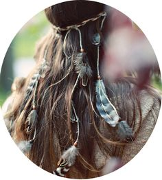 This is a handmade boho/native/hippie headband created with braided leather cording and/or hemp twine, with strands of feathers and beads. These