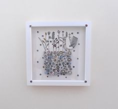 'Growing' is the first in a series of five works for Artweek Oxfordshire, May Taking eight hours to create, the circular shapes signify seeds from which stems are growing with a birdie looking on. A white washed box frame measuring by s. Emma Lou, Box Frames, Textile Art, It Is Finished, Shapes, Create, Handmade, Design, Hand Made