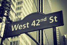 Street signs for West 42nd street in NYC by Jaroslav Frank