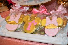 Pink and Gold Minnie Mouse sugar cookies for a first birthday party.