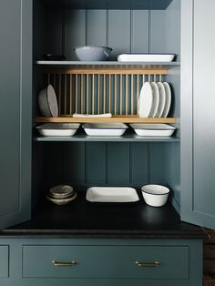 Beadboard can also serve as detailing inside cabinets, as seen with this wide-width beadboard in deVol's St John's Square showroom. Photograph courtesy of deVol. Cupboard Shelves, Kitchen Shelves, Kitchen Storage, Plate Racks In Kitchen, Inside Kitchen Cabinets, Kitchen Board, Cupboard Doors, Bathroom Storage, Kitchen Cabinet Styles