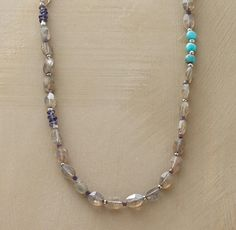 "LINEAR LABRADORITE NECKLACE -- Long stretches of labradorite are interspersed with segments of iolite and a turquoise trio. Handcrafted in USA exclusively for us. Sterling silver toggle clasp. 18""L."