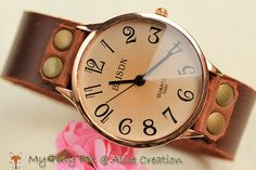 I NEED a statement women's watch. Something simple, probably silver color, with white or nude strap...or maybe something a little vintage-y, like this one...or both.