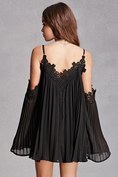A woven romper by Selfie Leslie™ featuring a pleated dress overlay, an open shoulder, a V-neckline with scalloped crochet trim, adjustable cami straps, detachable bell sleeves with scalloped crochet trim, a flowy silhouette, and an attached shorts lining. This brand runs small, please size up.