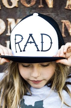 The RAD Hat by Hatch For Kids This is a rad hat. Literally. ···· Adult / Children's Snapback Mesh Trucker Cap Unisex Foam front / Mesh back / Flat visor Color options: White, Black One size fits all