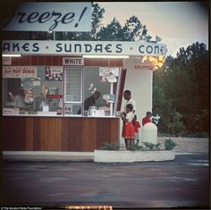 An African-American orders ice cream from the colored entrance of a store. Parks also directed a film version of his auto-biographical novel The Learning Tree in 1969, about a boy growing up in Kansas in the 1920s