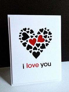 handmade Valentine card from I'm in Haven ... negative space die cut heart made of hearts ... Impression Obsession die ... luv how Lisa backed it in black except for two red hearts with glossy accents ... match the sentiment ... great card!