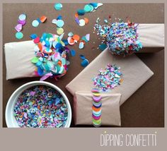This is the CUTEST idea. Cover prezzies in a thin layer of sticky stuff and dip em in a bowl of confetti!!