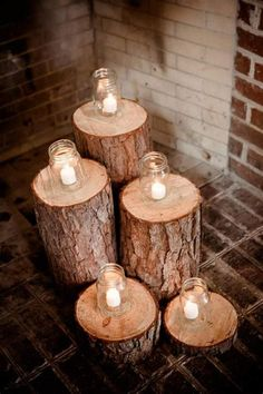 have a fireplace? Pop some candles atop logs for a rustic DIY effect.,Don't have a fireplace? Pop some candles atop logs for a rustic DIY effect.