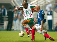 ... Senegal star El Hadji Diouf, breezes pass French defender Frank Leboeuf, during Senegal's 1-0 win over reigning champions France at the 2002 World Cup ...