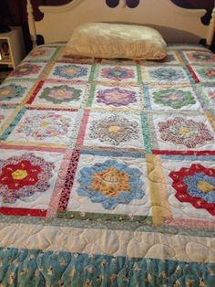 Grandmas flower garden quilt.  This is really updated with the sashing.  Something to consider?
