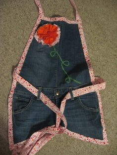A very cute full apron made from repurposed jeans. The trim and embellishment totally MAKES this apron.