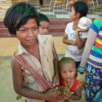 Young cambodian boy with little brother. Trueworldtravels.com