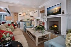 House of Turquoise: Brandon Architects | Love the living/sitting room off of the kitchen with a fireplace - it's a dream to have that in my house someday