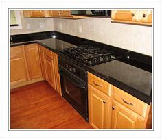 kitchen ideas with black appliances | black granite counter would look fantastic with your black appliances ...
