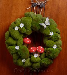 Moss Rock Wreath tutorial.  Cutie mushrooms or change it for each season.  Easy dollar store craft.