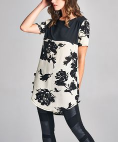 Add a pop of personality to your look in this breezy tunic decorated with a sophisticated floral print and sweet side-button detail for posh appeal. Size S: 32'' long from high point of shoulder to hem95% polyester / 5% spandexMachine wash; tumble dryMade in the USA