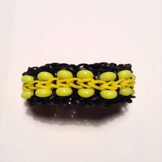 Black and yellow rubber band bracelet with by cutiepiebracelet