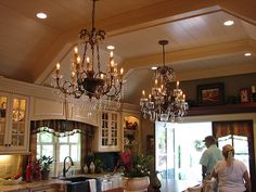 via Timeless Settings blog - Love this ceiling and the chandy's ....and the shelving over the double doors