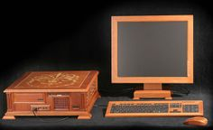 Wooden PC case, monitor, keyboard, and mouse. Redwood.