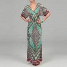 Caftan-style maxi dress with blue-green and orange detail.