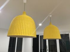 IKEA hack. Yellow and white pendants for the kitchen.