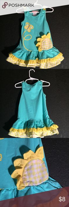 Girls turquoise and yellow sunflower dress size 5 Girls turquoise and yellow Sunflower sundress made by Kid Headquarters Simple yellow bows on shoulders butterfly and rick rack design. Yellow check ruffle skirt trim.  Size 5 Dresses Casual