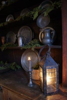 Primitive Christmas - Pewter and Greens with a lit Antique Lantern Look so beautiful for fall or winter night -