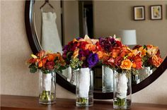 Bouquets of orange and purple flowers really capture the essence of a fall wedding.